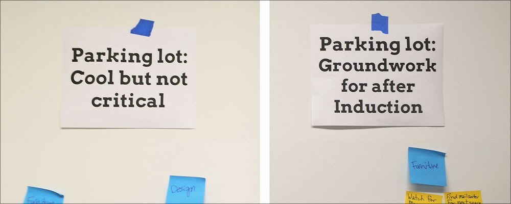 Photo of a paper parking lot sign where ideas on sticky notes can be posted for later consideration