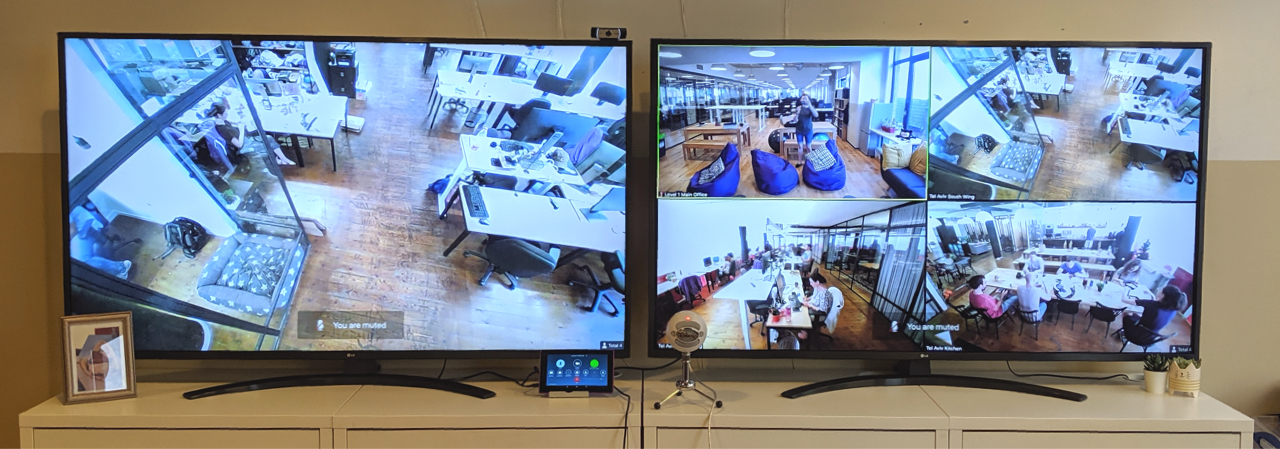 a photo of two TV screens side by side displaying video streams from different offices.